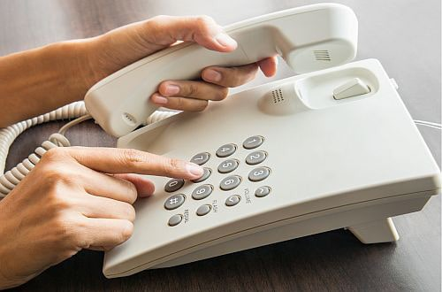 Dialing the phone to book an online psychological therapy