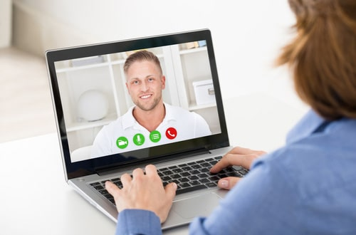 woman having an online psychological therapy session